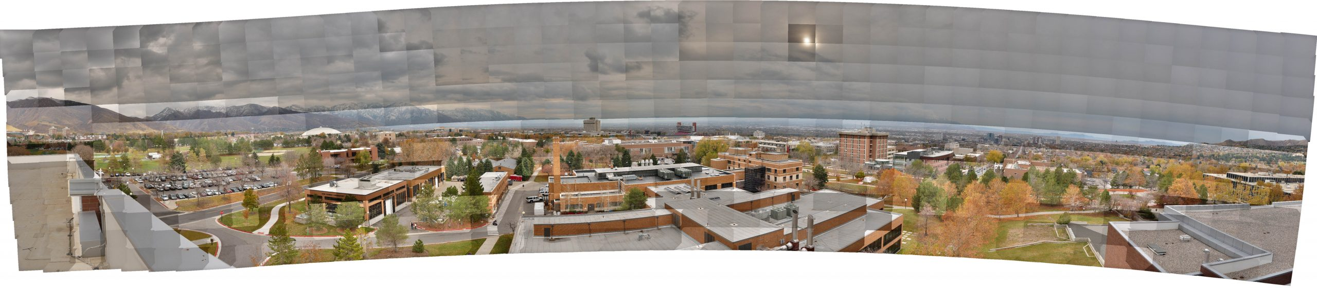This panoramic mosaic of the Salt Lake Valley was taken by a camera mounted on a robotic panning device atop a University of Utah building. It consists of more than 600 separate photographs that contain a total of 3.27 gigapixels (3.27 billion pixels) of image data. The seams between individual photos are readily apparent, as are differences in light exposure. To edit the photos into a single, seamless, evenly exposed panorama would take hours using normal methods to edit such huge images. The mosaic has been reduced to about 1 megabyte in this image. See next image.
