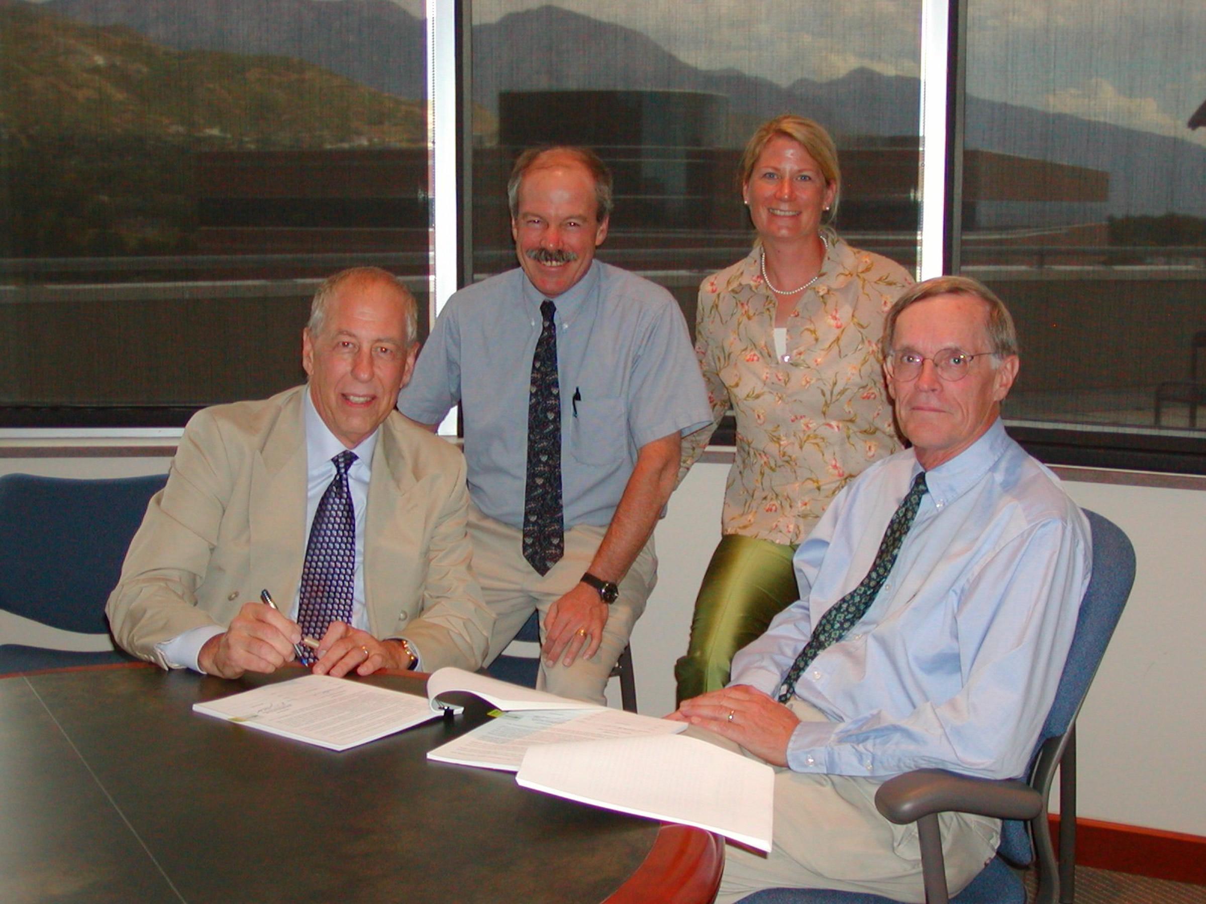 Left to right: Dr. Richard K. Koehn, President & CEO, Sentrx; Dr. Glenn D. Prestwich, Chairman of Medicinal Chemistry, U of U; Sheryl G. Hohle, Sr. Licensing Manager, U of U; and Dr. Raymond F. Gesteland, Vice President of Research, U of U.
