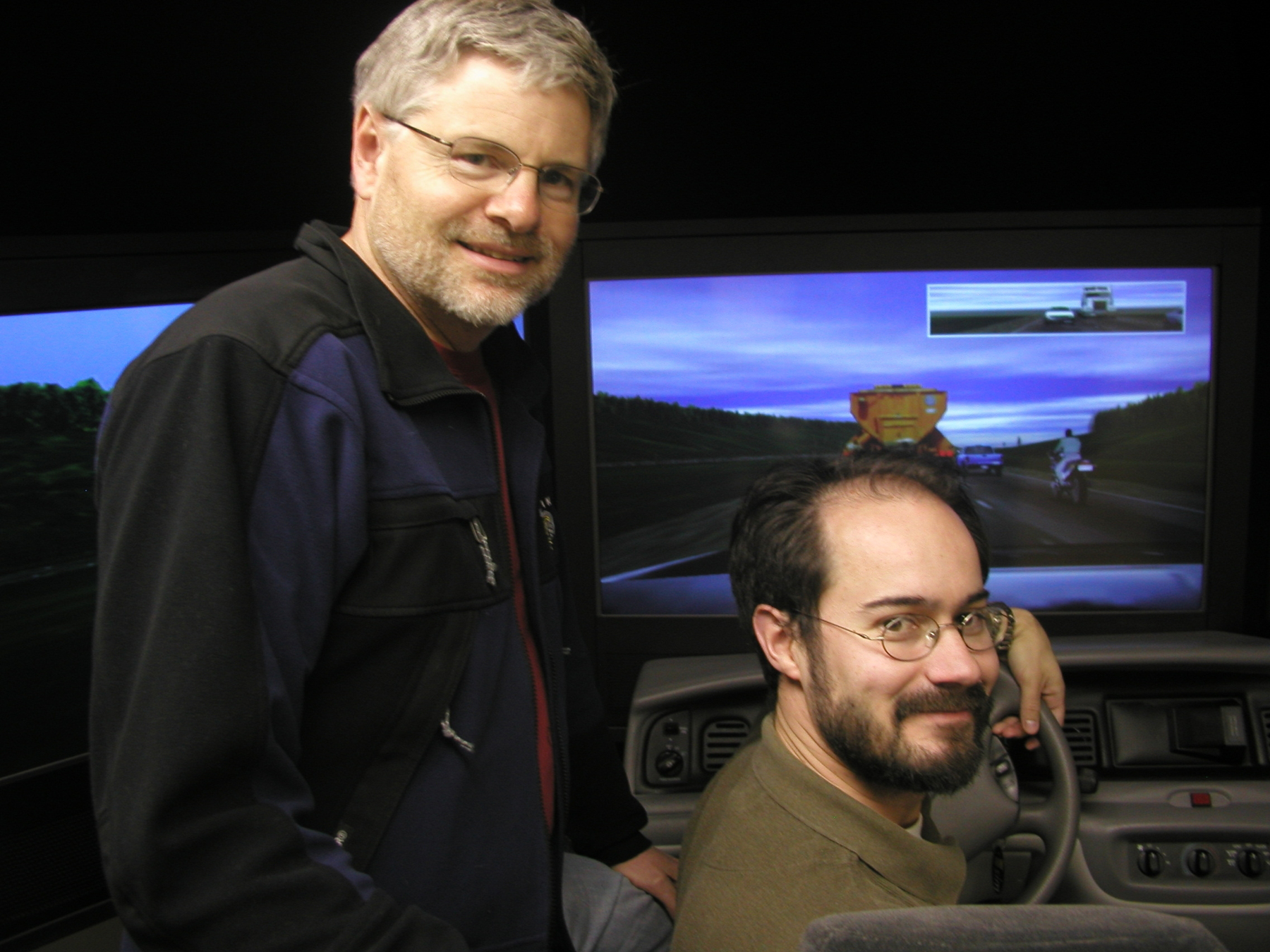 University of Utah psychologists David Strayer and Jason Watson in a driving simulator they use to study how cellular phones and texting distract drivers. Their latest study found that 39 out of 40 people cannot drive safely while talking on a cell phone.