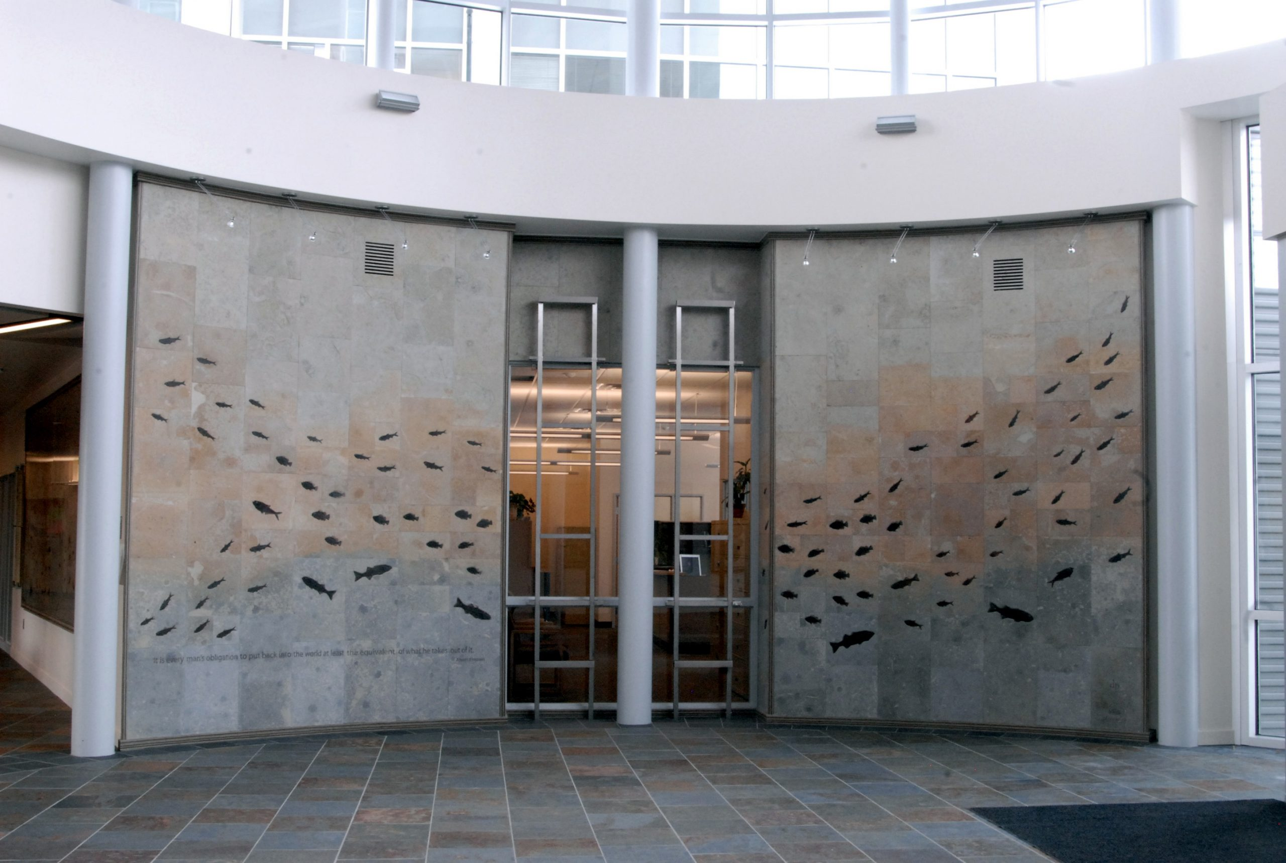 """Dozens of fossilized fish from the Green River Formation seem to swim in the """"fish wall"""" in the lobby of the University of Utah's new $25 million geology building, the Frederick Albert Sutton Building."""