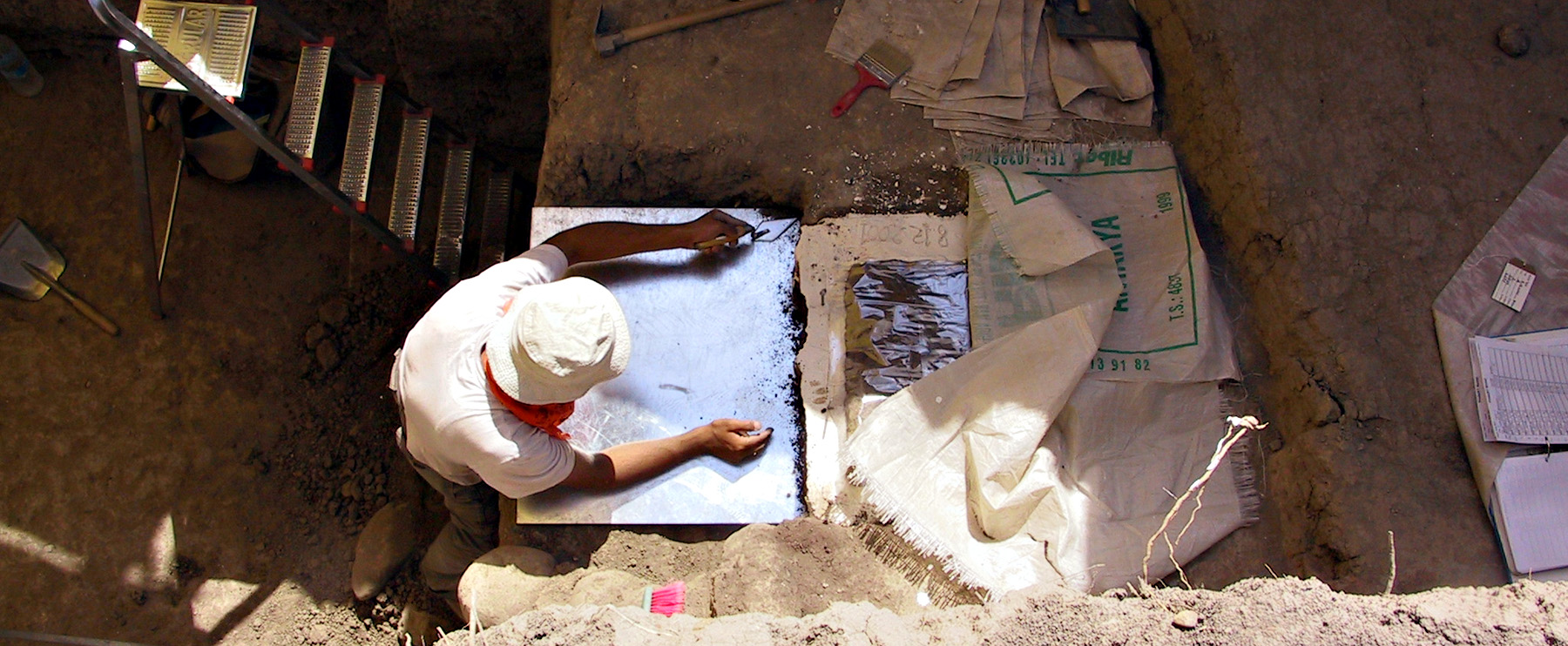 A turkish student works in a trench at the ancient village of Kenan Tepe, Turkey, site of an archaeology project led by the University of Utah.