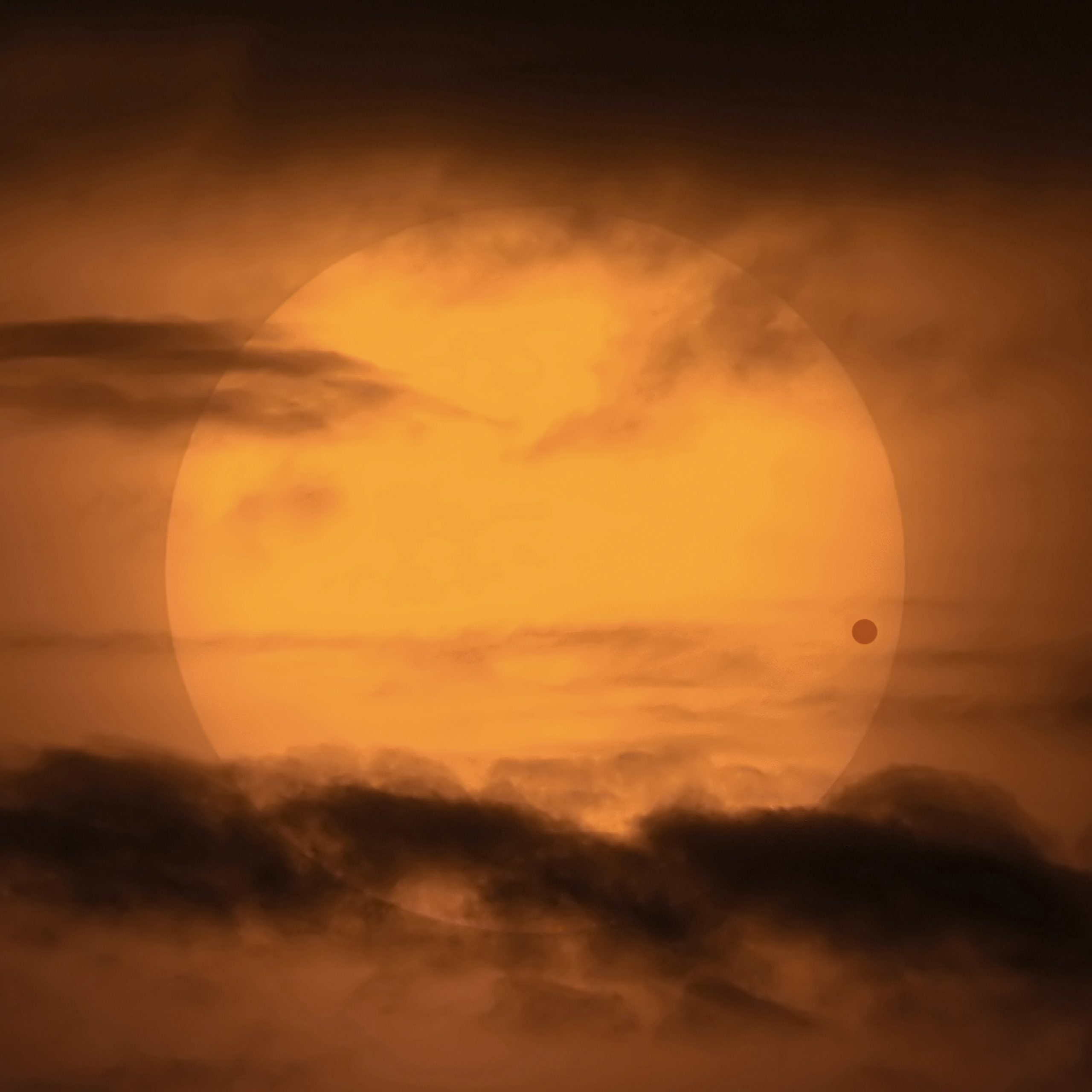 Image of Venus transiting the sun in 2004. The planet is visible near the right edge of the sun.